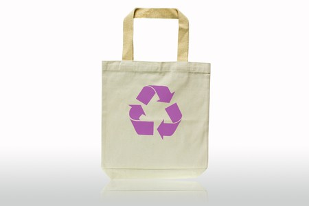 replaces: Shopping bag made out of recycled materials isolated on white background, Ecologically friendly, replaces plastic shopping bags.  Image