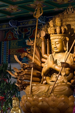 Thousand hands of god image make of wood carving chinese art in thailand