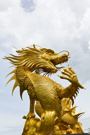 Colorful Golden dragon statue in chinese temple Thailand Stock Photo