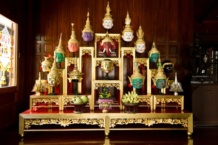 Khon Masks is situated on the set of altar table Stock Photo