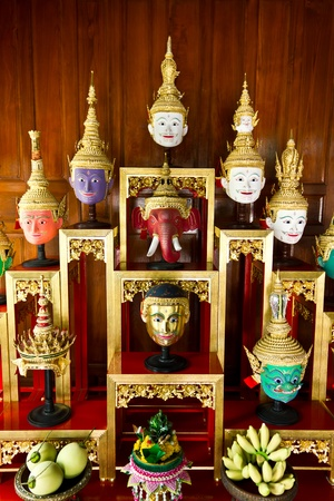 khon: Khon Masks is situated on the set of altar table Stock Photo