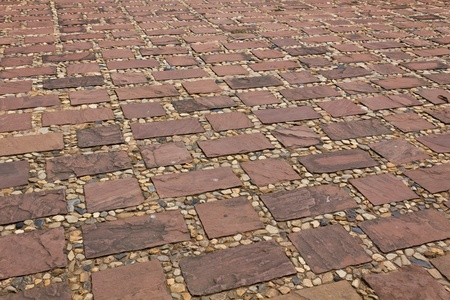 Stones of the pavement pattern of brick background Stock Photo - 9112472