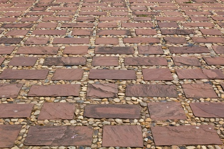 Stones of the pavement pattern of brick background Stock Photo - 9169340