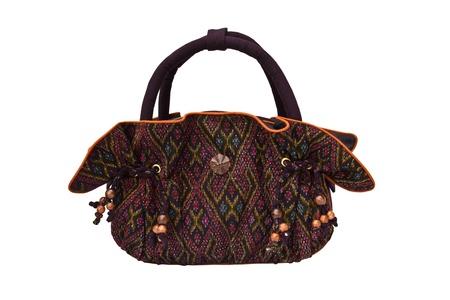 Handbag made of Thai silk patterns Mudmee from Lopburi, Thailand. Stock Photo