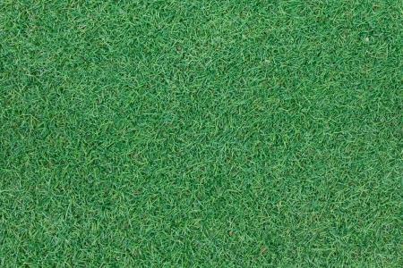 Achtergrondstructuur met nep gras in een openbare Speeltuin, bovenaanzicht Stockfoto