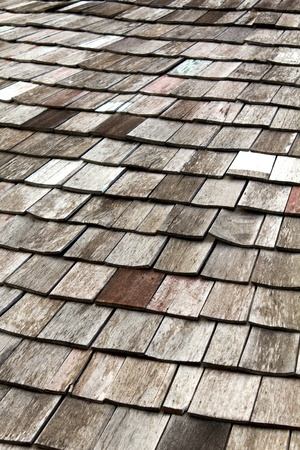 old worn shingle roof pattern in thailand Stock Photo - 9602388