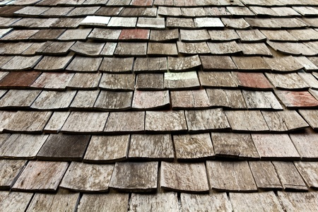 old worn shingle roof pattern in thailand photo