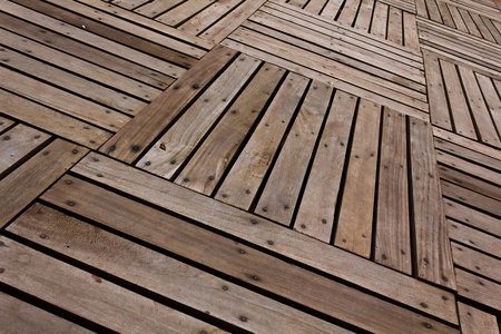 Patterns and textures of a wooden planks pavement Stock Photo - 10348639