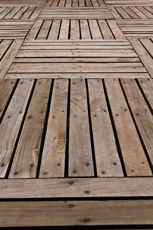Patterns and textures of a wooden planks pavement Stock Photo - 10348636