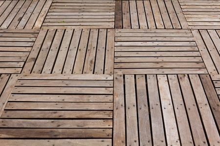 Patterns and textures of a wooden planks pavement