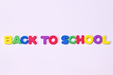 colorful letters with BACK TO SCHOOL isolated on white background photo