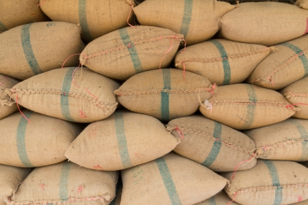 Old hemp sacks containing rice placed profoundly stacked Stockfoto