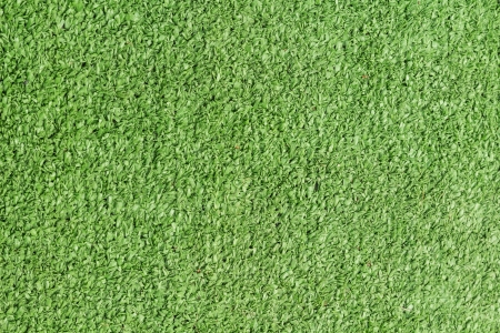 Background texture with fake grass in a public children playground, top view Stock Photo