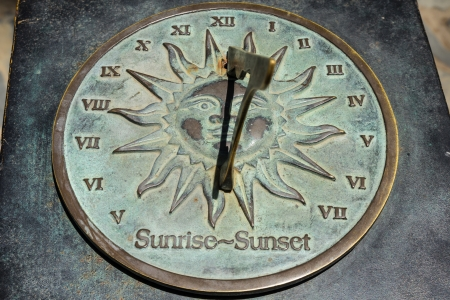 Old sun clock dial - Vintage sundial with shadow Stock Photo