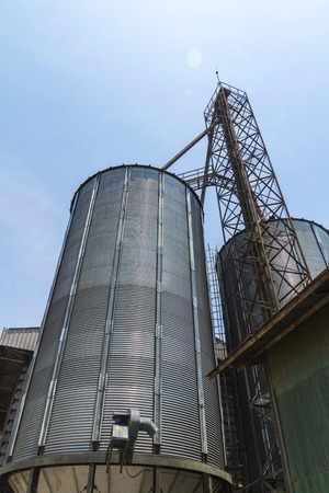 Big metal silo agricultural granary in Thailand Stock Photo