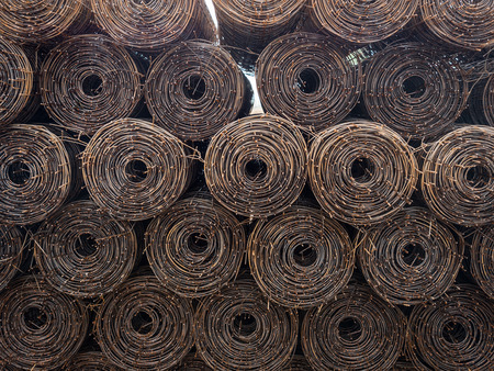 Stacked steel wire roll ready for construction.