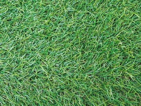 Achtergrond textuur met vals gras bovenaanzicht.