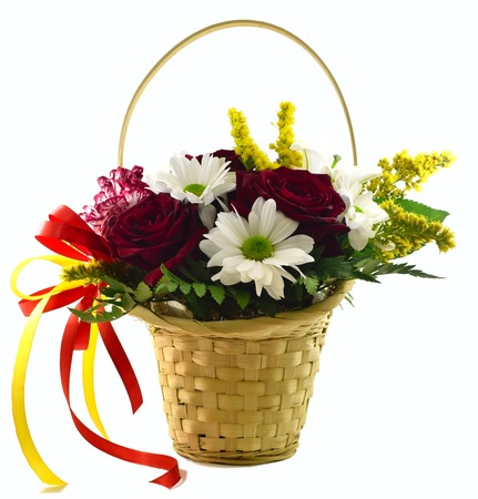 celebration: basket with flowers on a white background Stock Photo