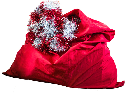 Santa Claus red bag, isolated on white background. Red big Santa Christmas sack full of gifts