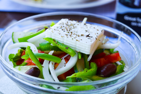 Greek salad with fresh vegetables.