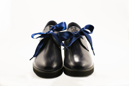 A pair of dark blue leather womens boots