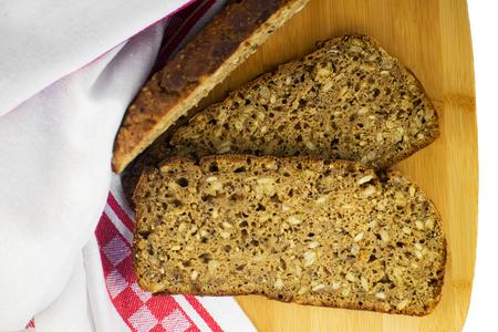 Sliced rye bread on cutting board. Whole grain rye bread with seeds.