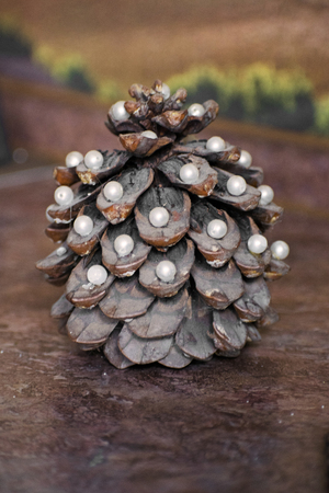 Pine cone in the form of a New Year tree. Pine cone decorated with pearls.