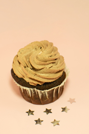 Beautiful hoemade chocolate cupcake with butter cream and cocoa.