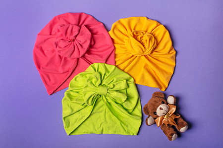 Delicate three bright turbans for women, girls or baby. Turban fashion or bandana hair accessories for the beach and travel. Archivio Fotografico