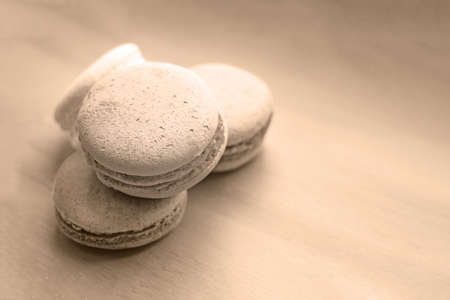 Sweet and delicate macarons on set sail champagne background. French dessert. Stok Fotoğraf