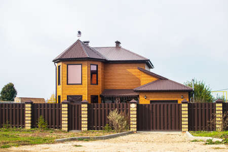 Beautiful two-storey country house. Wonderful village life. 写真素材