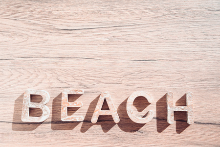 Summer Bacground With Beach Accessories On Wooden Board. White heart. Stock Photo
