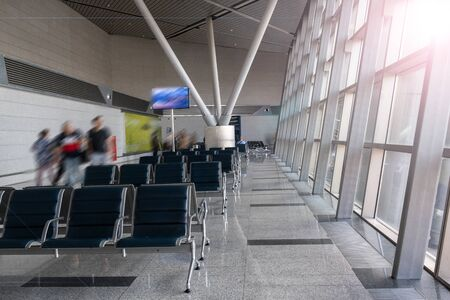 There are empty chairs, benches for passengers waiting for flights at the airport terminal, selected focus Foto de archivo
