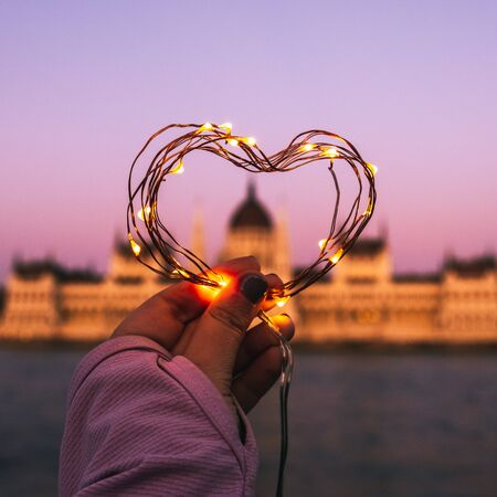 Heart from lights at the background of Parliament building of Budapest, Hungary