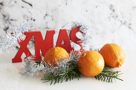 fir branch: xmas sign with silver tinsel, fir branch with clementine and stars