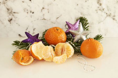fir branch: fir branch with clementine and stars Stock Photo
