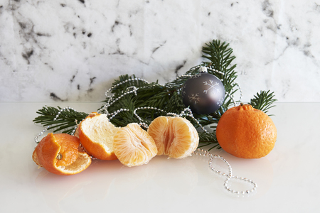 fir branch: fir branch with clementine and silver grey Christmas ball