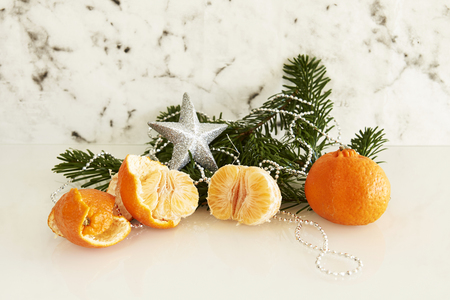clementine fruit: fir branch with clementine and silver star Stock Photo