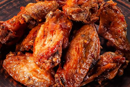 grilled chicken wings in red sauce close-up