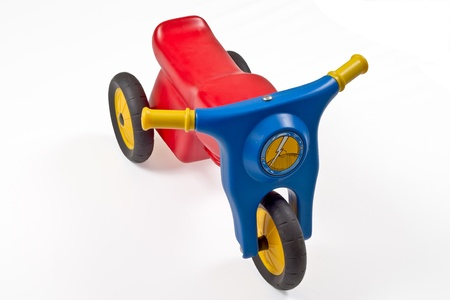 Red,blue,yellow toy motorcycle isolated on white Stock Photo