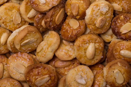 Biscuits background - Top view of biscuits with almonds photo