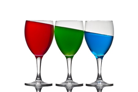 Three wine glasses with  colored liquid depicting the RGB color system