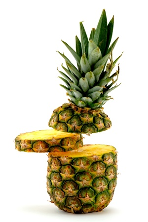 Pineapple with slice floating in the air on white background