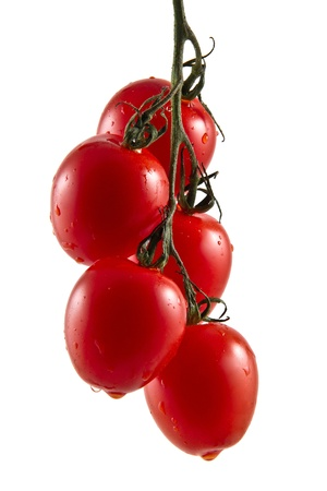 Hanging truss of five fresh vine tomatoes isolated on white background Stock Photo
