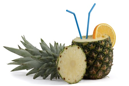 Pina Colada in Pineapple with orange and straws, isolated on white Zdjęcie Seryjne