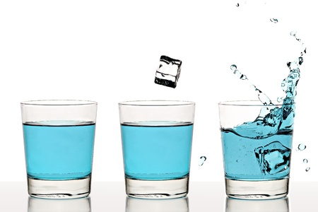 triptych: Triptych of an ice cube falling into a glass of liquid Stock Photo