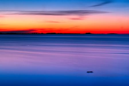 Minimalistic sunset over sea Stock Photo