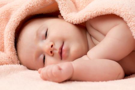 Adorable newborn baby girl is falling asleep photo