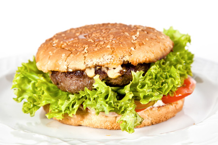 Burger with beef, lettuce, tomatoes and cheese photo