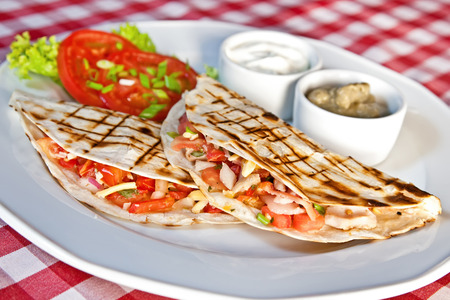 Barbecue chicken and cheddar quesadillas with salsa photo